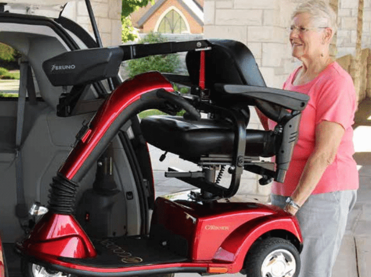 Unique Auto Service - Assisted Mobility Woman on Mobility Equipment
